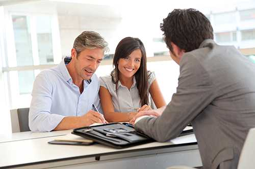 couple-paperwork-real-estate